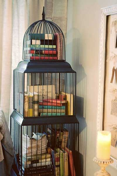 Birdcage with Books2 Decorating with Birdcages   12 Creative Ideas for Everyday Use