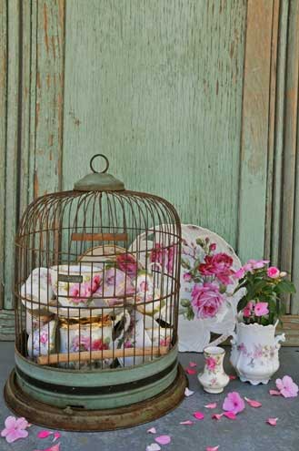 Birdcage with Dishes2 Decorating with Birdcages   12 Creative Ideas for Everyday Use