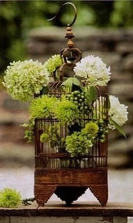 Birdcage with Flowers2 Decorating with Birdcages   12 Creative Ideas for Everyday Use