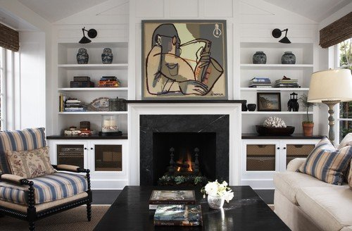 tv above fireplace covered by art