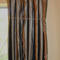 Curtains Loosely Tied with Twine to Train