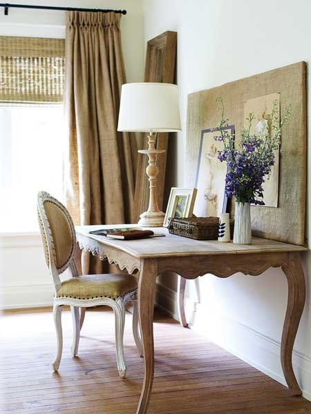 french writing desk with bulletin board leaning on top purple flowers and lamp