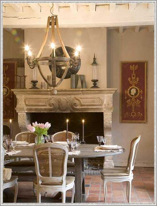 A Fanciful Chandelier Casts Warm Light in This Romantic Rustic Dining Room
