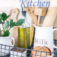 kitchen vignette with glass pitcher holding wooden utensils