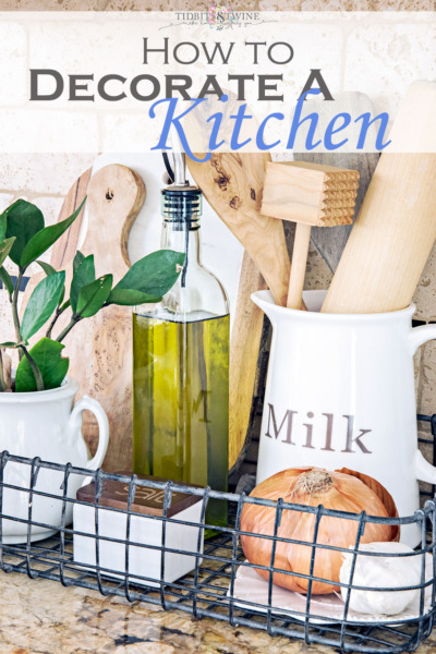 kitchen vignette with glass pitcher holding wooden utensils