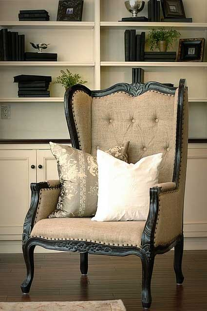 Black wingback upholstered in burlap with tufted back and nailhead trim