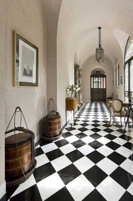 European foyer with black and white checkered tiles and white walls
