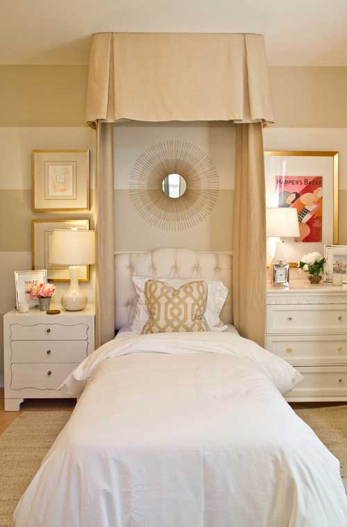 bedroom with tufted headboard and bed canopy and mismatched nightstands