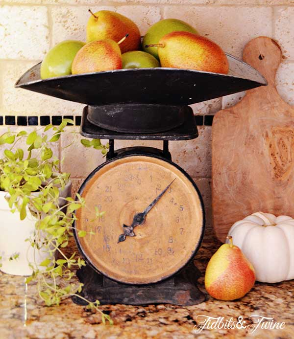 Vintage scale holding pears and apples for a fall vignette