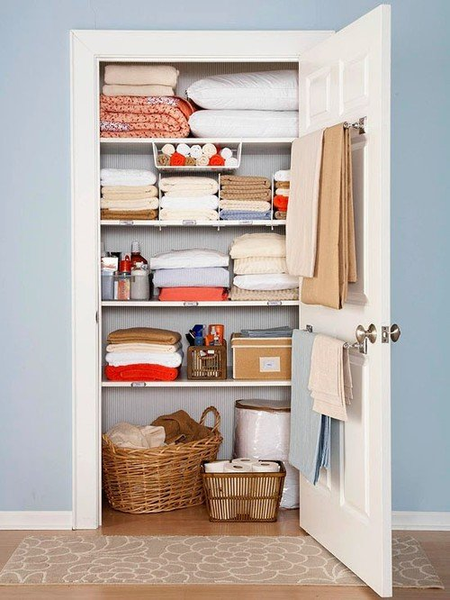 Ticking wallpaper linen closet