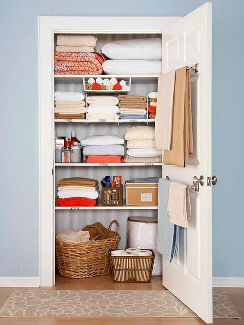 Ticking wallpaper linen closet