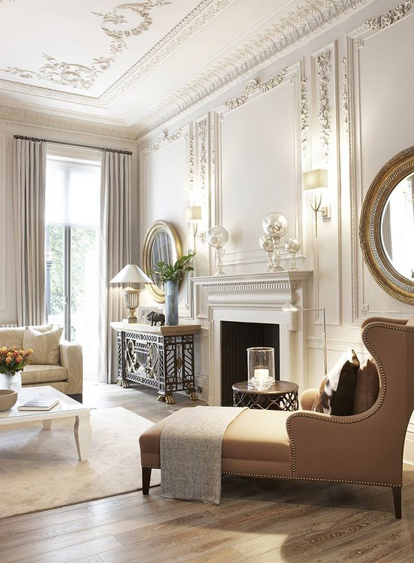 French style living room with lots of molding on the walls and ceiling wood floors and neutral furniture