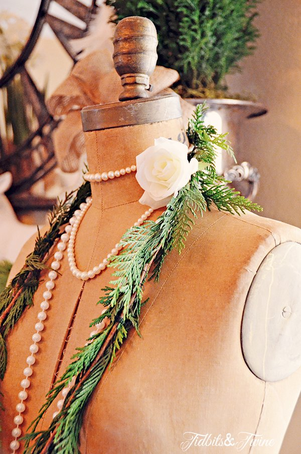 Vintage dress form with cedar necklace for Christmas