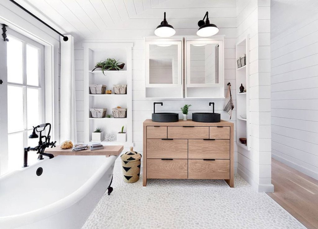 Bathroom with shiplap walls pebble floor and freestanding tub