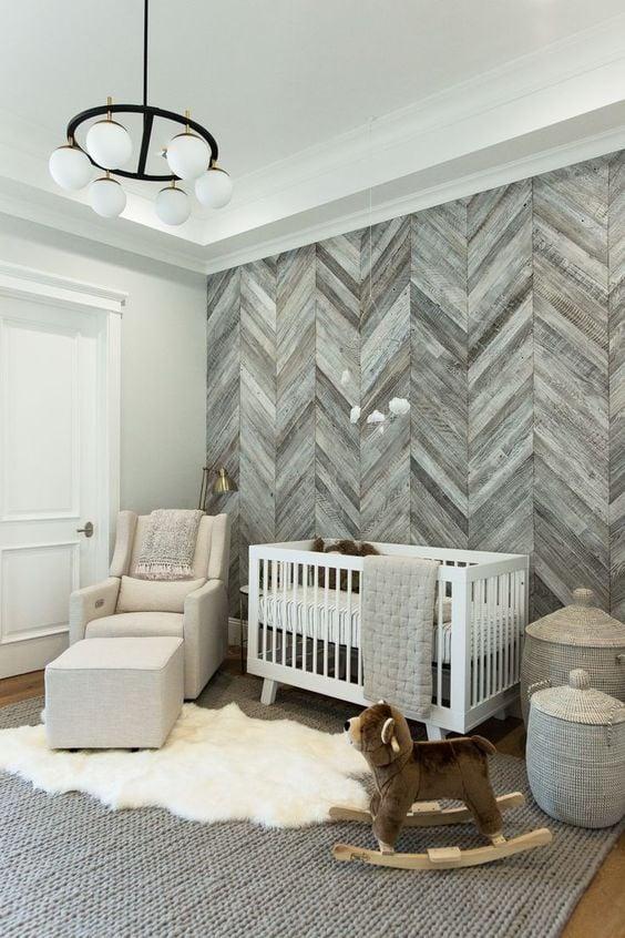 DIY herringbone planked wall in baby nursery