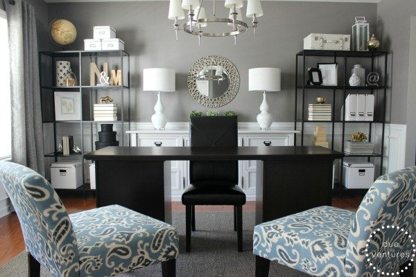 Gray home office with black furniture and blue accents chairs