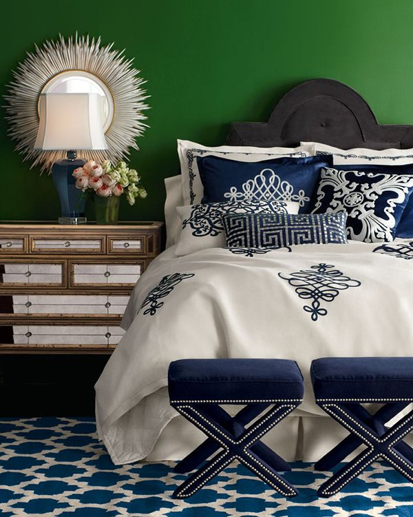 Bedroom with green walls and navy blue and white bedding