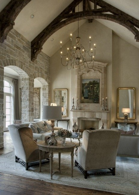 Formal European living room with stone walls and wooden beam arches