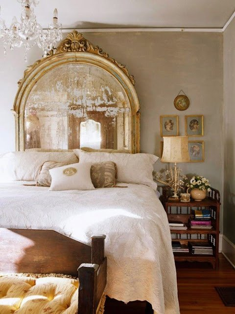 Oversized French mirrored headboard in bedroom