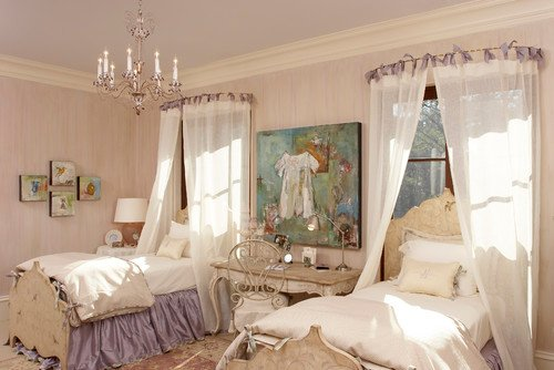 A French style bedroom with twin beds and with bed crowns and purple bedskirts