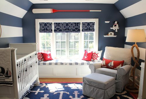 Nautical themed baby nursery in blue white and red with blue and white striped walls