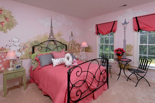 A Parisian themed girls bedroom with pink Eiffel tower mural and black accents