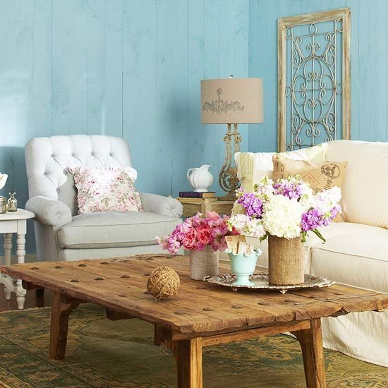 French country living room rustic coffee table with two flower arrangements on top