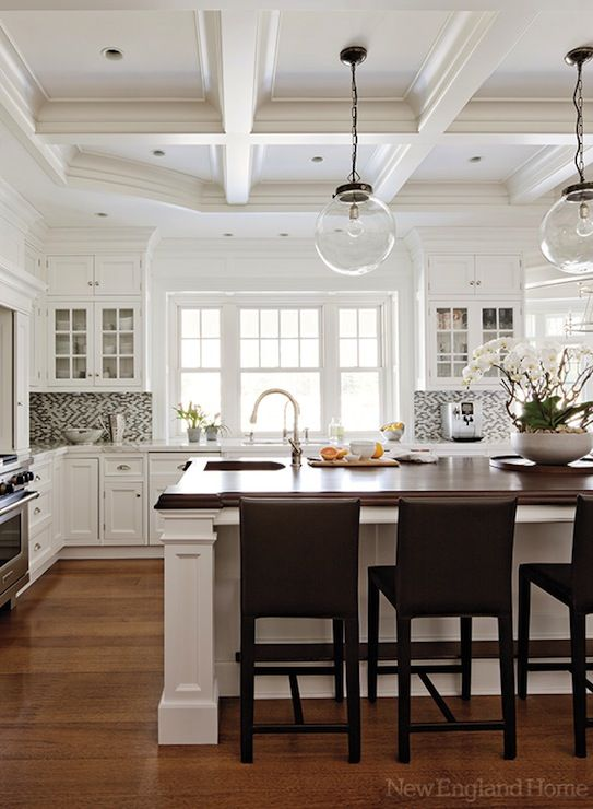{A tall ceiling allows for extra architectural detail and dimension. Source}