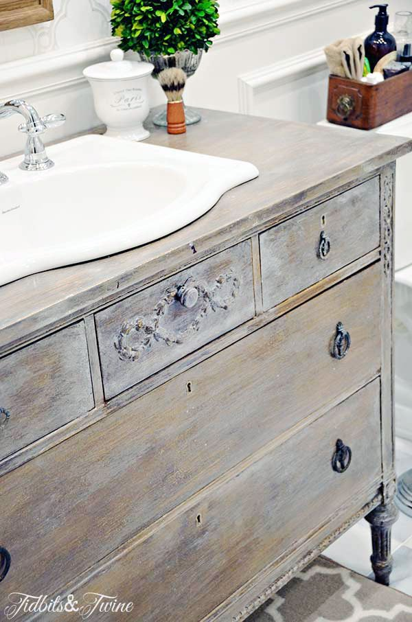 French wooden dresser turned into a bathroom vanity with marble floors