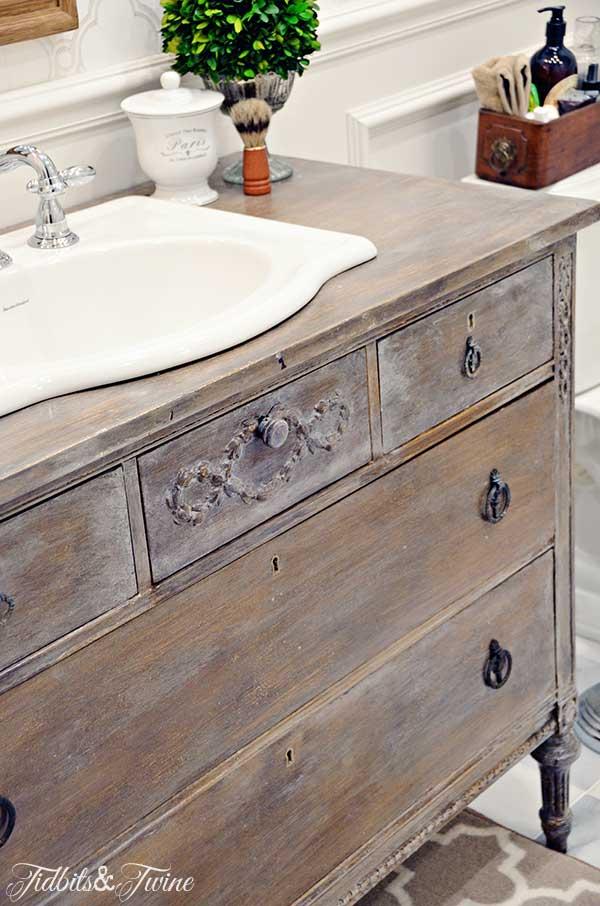 TIDBITS&TWINE Guest Bathroom Remodel - A vintage dresser converted into a vanity