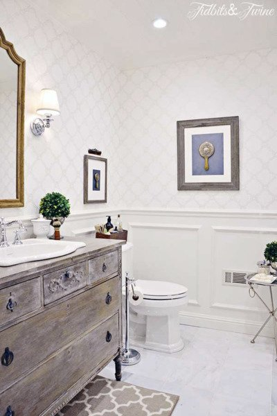 bathroom makeover with dresser vanity trellis wallpaper beadboard ceiling and carrara marble