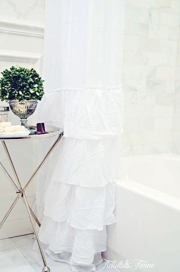 diy white ruffle shower curtain panel for tub shower combo with silver table next to it