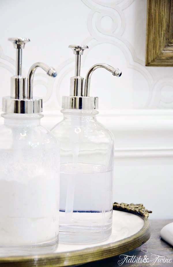 closeup of vintage inspired soap dispensers in a bathroom remodel