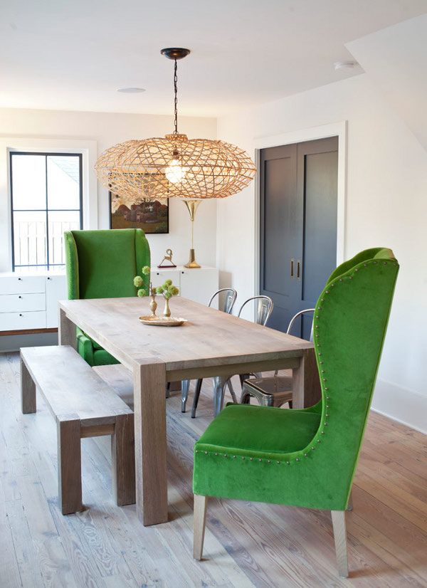 Wingback Green Head Chairs in a contemporary dining room with bench seating