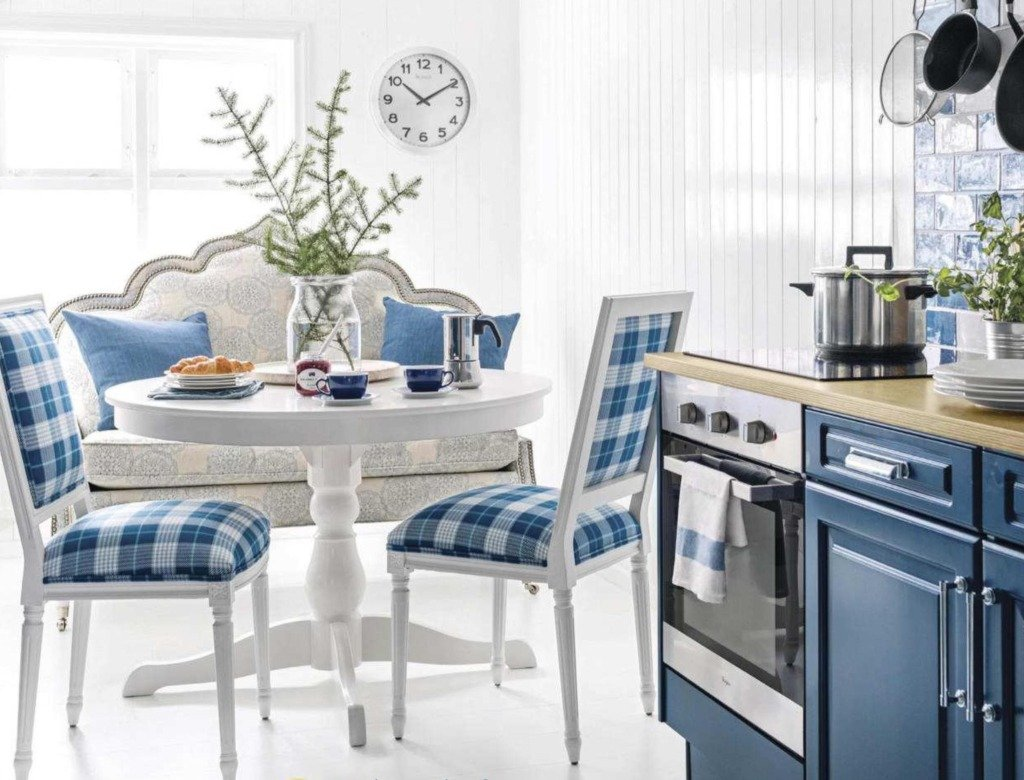 white and blue french kitchen eating area with settee and blue plaid chairs