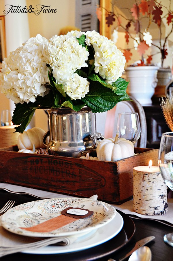 White Fall dining tablescape with candles and baby boo pumpkins