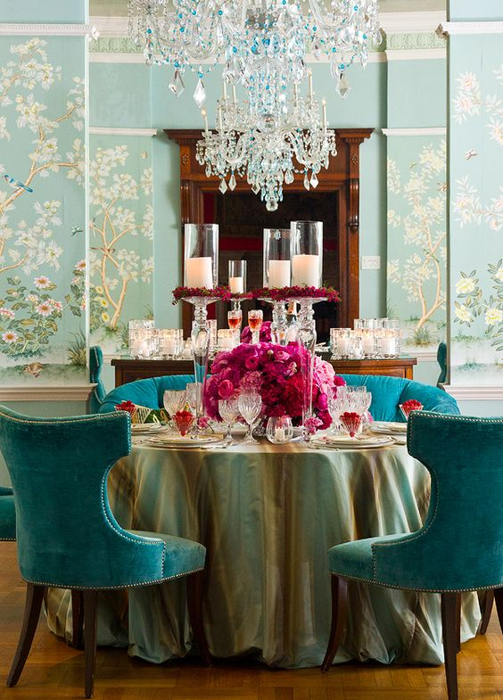 Blue wallpaper in a dining room with blue seating and pink roses