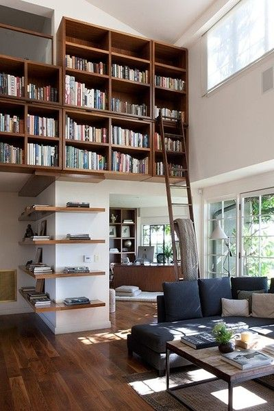 Brown modern bookcase floating on a wall with a ladder to reach the books