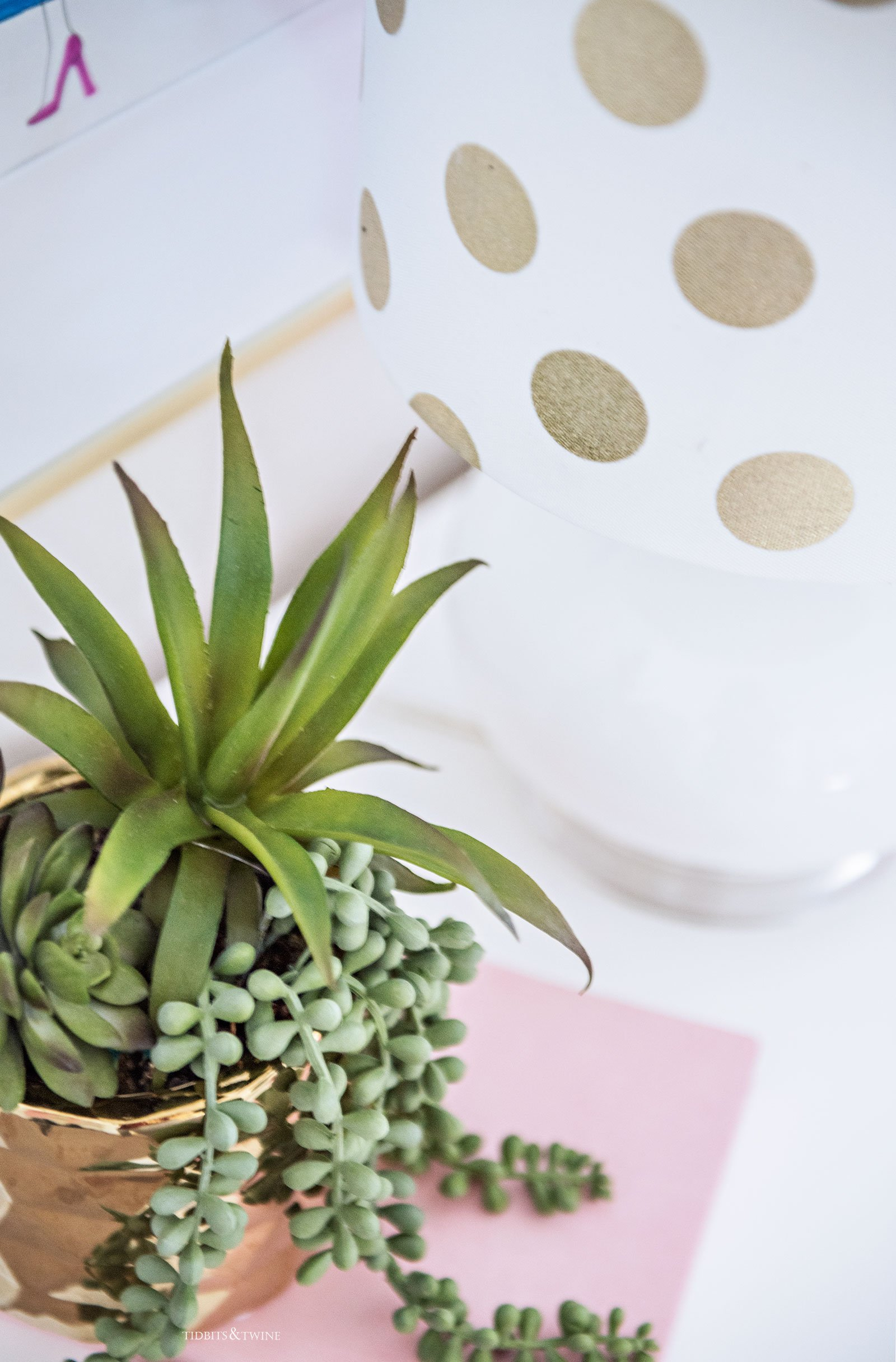 Faux succulents in gold vase on nightstand in tween girl bedroom