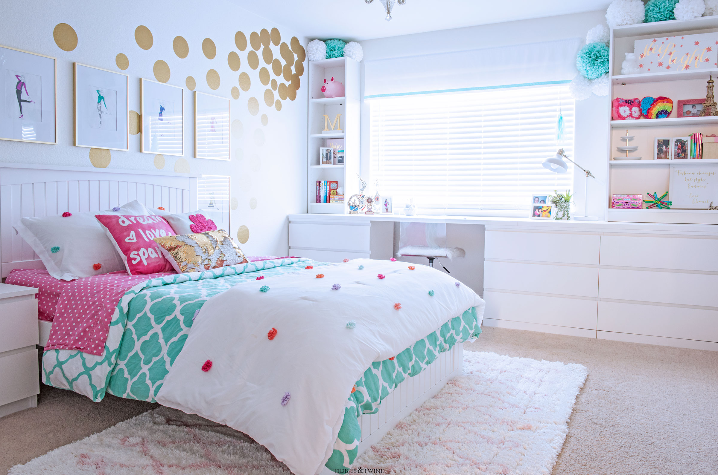 girls bedroom with IKEA hack built in desk and shelves white walls with gold polka dogs and turquoise and pink bedding
