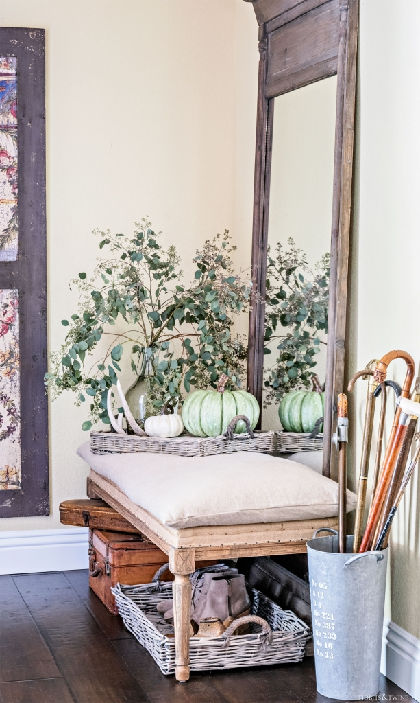 French Farmhouse foyer entryway decorated for fall with large wooden mirror and burlap bench