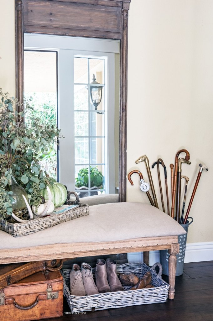 French Farmhouse foyer decorated for Fall with a french style bench