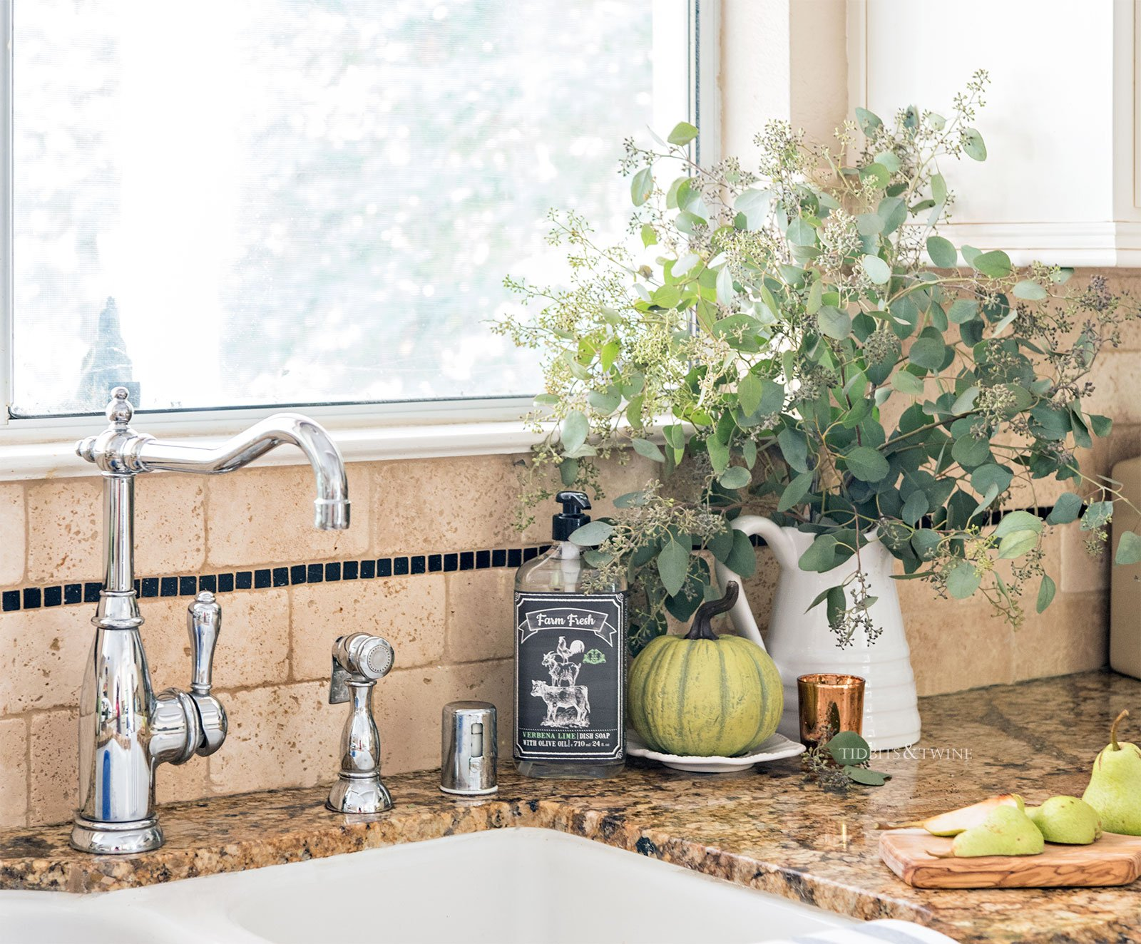 Farmhouse kitchen sink decorated for fall