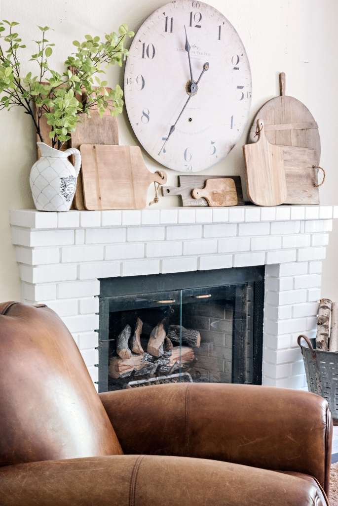 wooden cutting board collection on mantel - How to Decorate with Antiques