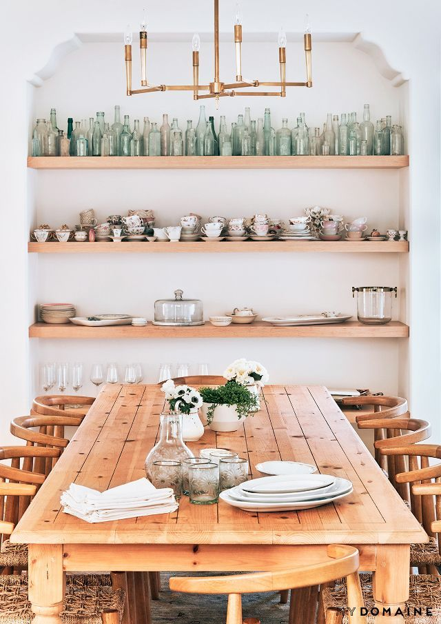 Opening kitchen shelving with bottle collection