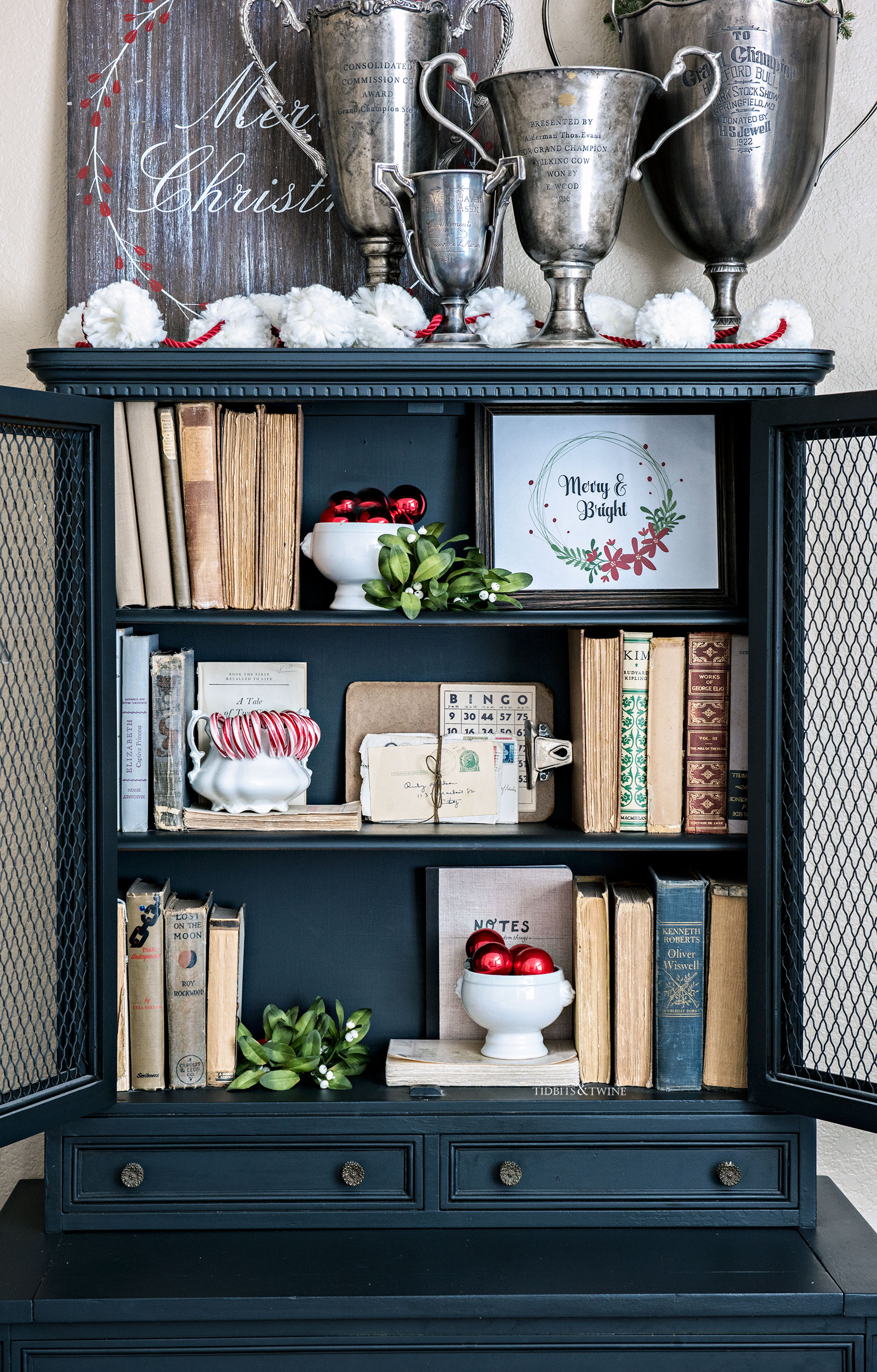 black cabinet shelves decorated for Christmas