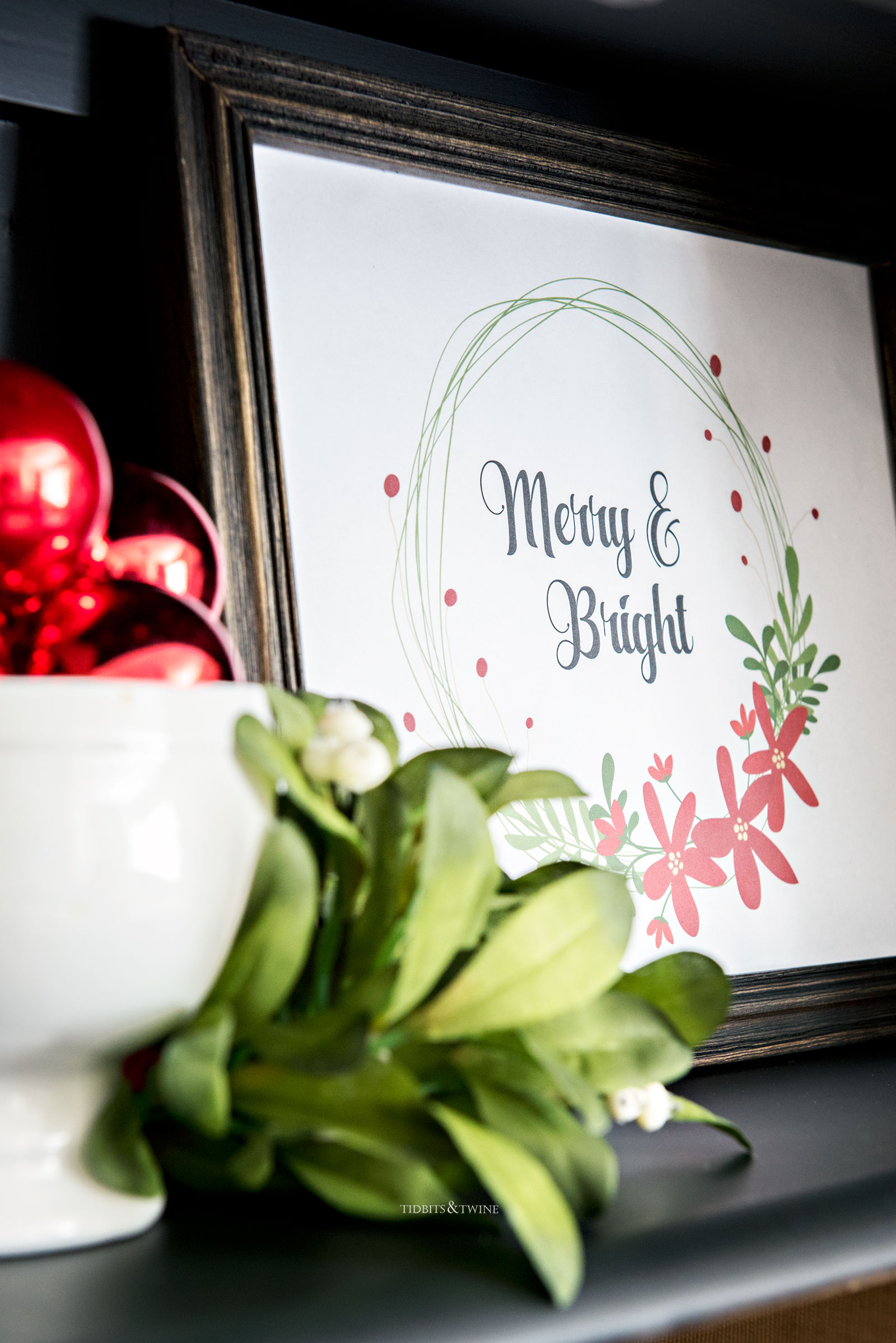Free Christmas printable frame and displayed on a shelf