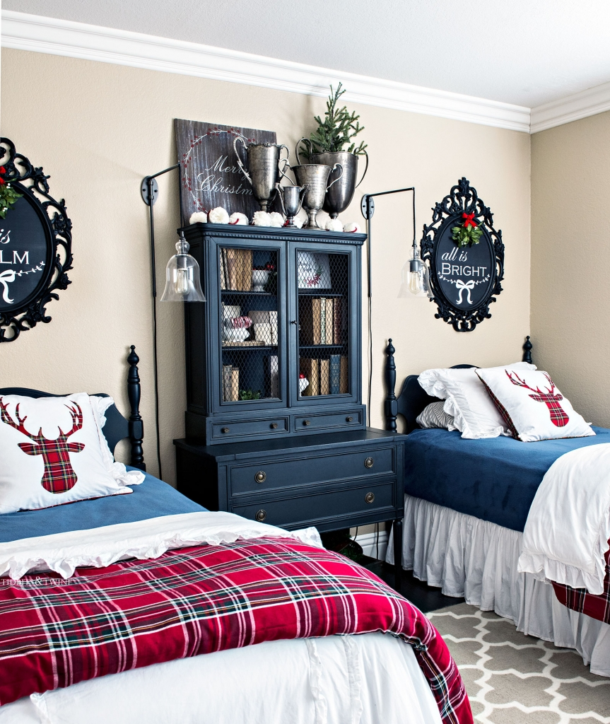 bedroom with twin beds decorated for Christmas with red plaid, black furniture