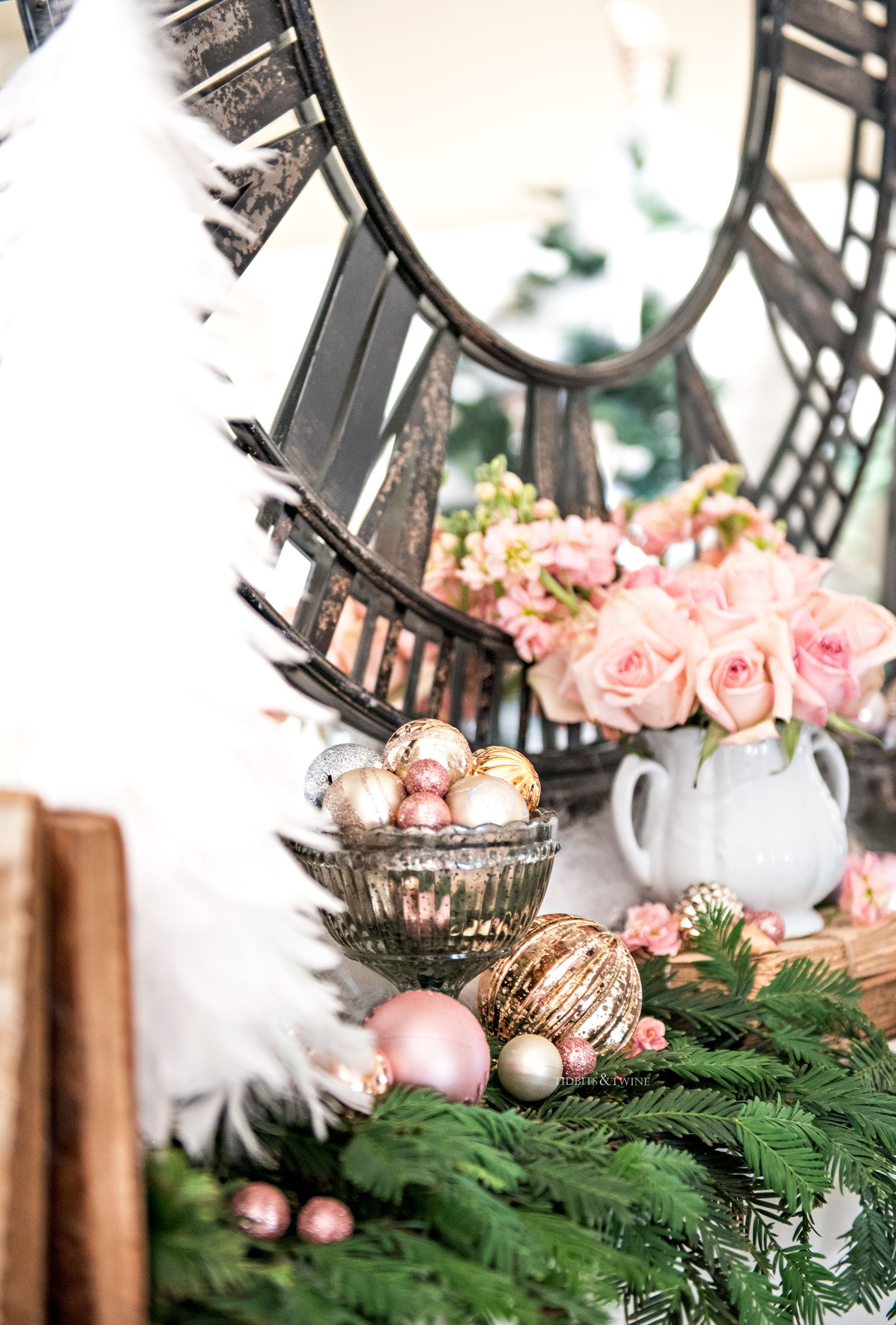 Fireplace mantel with white feather Christmas tree decorated with pink ornaments and roses