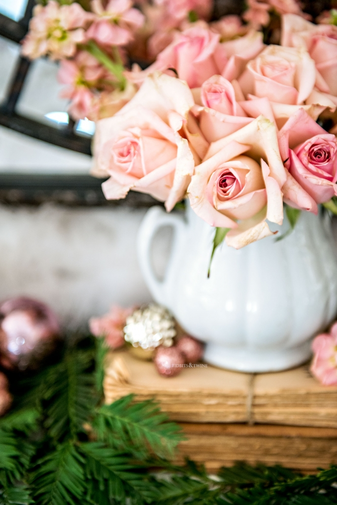 Pink roses in an antique ironstone sugar bowl on fireplace mantel